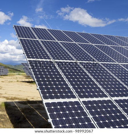 group of photovoltaic solar panels to produce renewable electrical energy - stock photo