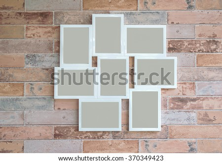 group of picture frame on brick background - stock photo