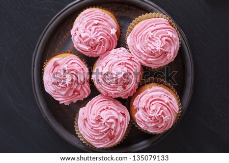 Group of pink cupcakes selective focus - stock photo