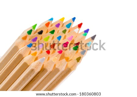 Group of plain wood multi colored pencil crayons arranged diagonally from the left corner with their sharpened colorful points to the center of the frame isolated on white with copyspace - stock photo