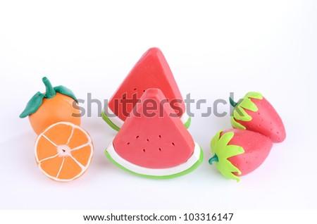 group of plasticine fruits orange watermelon and strawberries - stock photo