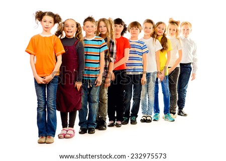 Group of positive children standing together. Isolated over white. Full length portrait. - stock photo
