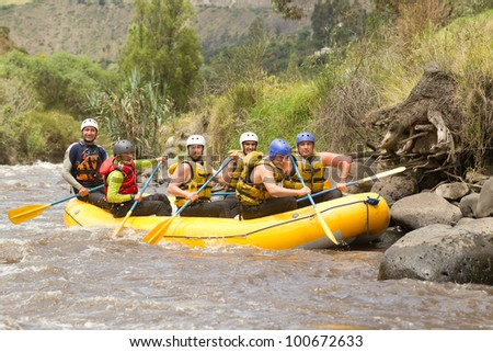 Group of powerfull young men on a rafting boat. Patate river , Ecuador. Shoot with Canon 1D Mark IV from water level. - stock photo