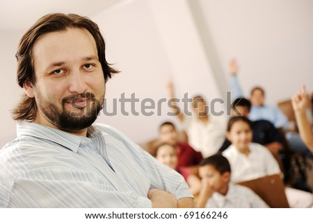 Group of preschool kids and their teacher in classroom, school, education concept - stock photo
