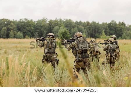 group of  rangers conducting an offensive against the enemy - stock photo