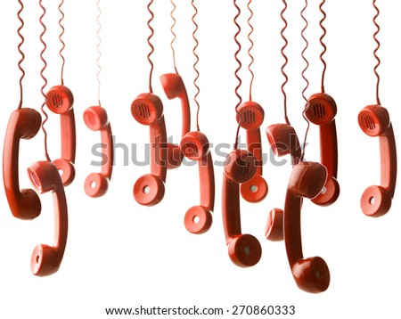 group of red handsets from vintage phones hanging against white background. selective focus - stock photo