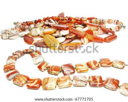 group of red jasper beads isolated on white background - stock photo