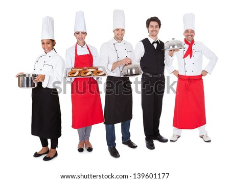 Group of restaurant chef and waiters. Isolated on white - stock photo