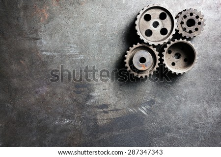 Group of rusty transmission gears on table close up - stock photo