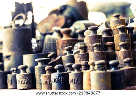 Group of rusty vintage weights. Cross process. Retro filtered. Selective focus. Low depth of field. - stock photo