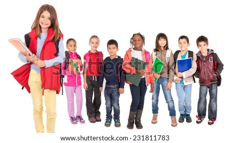 Group of school children posing isolated in white - stock photo