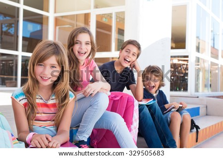 Group of school kids sitting on stairs - stock photo