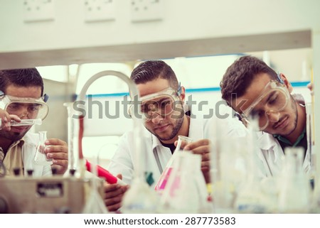 Group of scientists conducting research in a lab environment - stock photo