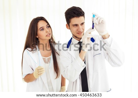 group of scientists working at the laboratory Laboratory concept with caucasian male chemist. Horizontal template for a poster, webpage or leaflet.  - stock photo