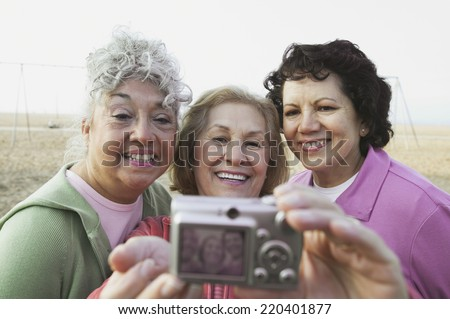 Group of senior women taking a photograph of themselves - stock photo