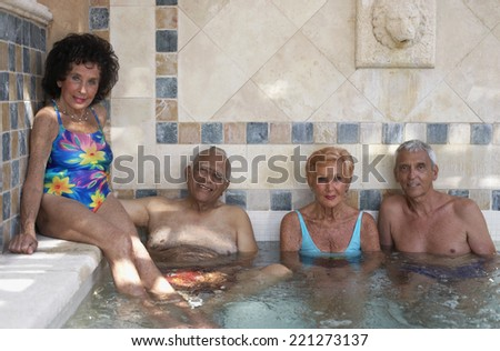Group of seniors in hot tub - stock photo
