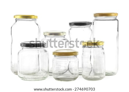 Group of seven different empty glass jars for preserves - stock photo