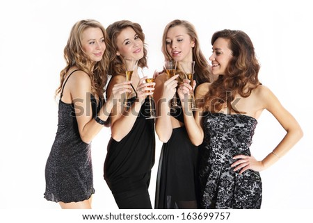 Group of sexy young women toasting with champagne / Beautiful young women in sexy dresses toast a glass of champagne - stock photo