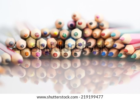 Group of sharp colored pencils with white background and reflexions  - stock photo