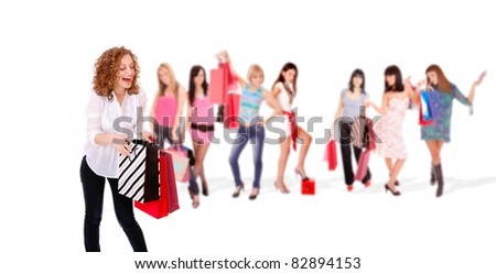 Group of shopping girls over white background - stock photo