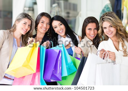 Group of shopping women looking very happy - stock photo