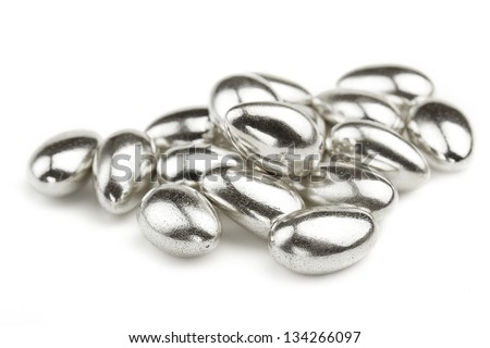 group of silver sugared almonds on white background - stock photo