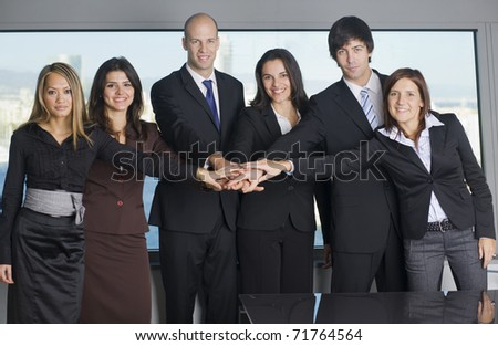 Group of six businesspeople putting their hands on one hand - stock photo