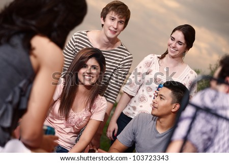 Group of six happy young people outside - stock photo