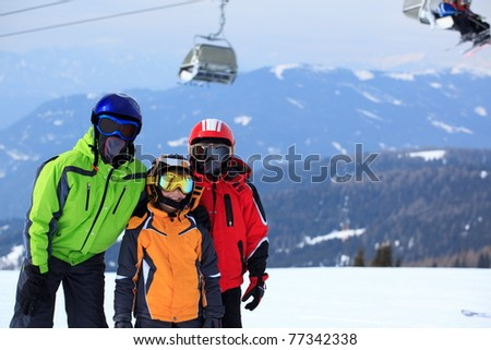 Group of skiers on mountain side with chair lift in background. - stock photo