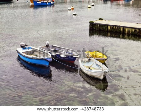 Group of small fishing boats; working row-boats with fishing paraphernalia etc; shot from above  - stock photo