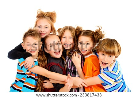 Group of smiling children standing together. Isolated over white. - stock photo