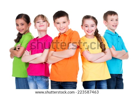 Group of smiling children with crossed arms in colorful t-shirts standing together on white background. - stock photo