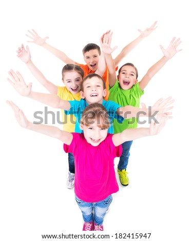 Group of smiling children with raised hands in colorful t-shirts standing together. Top view. Isolated on white. - stock photo