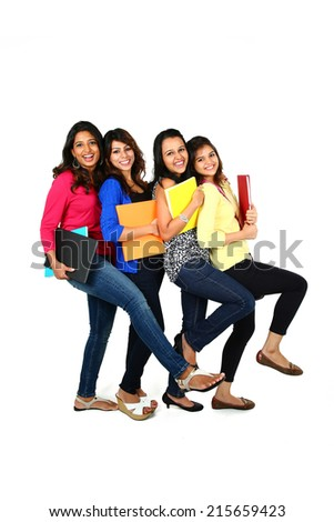 Group of smiling female friends/students, isolated on white background - stock photo