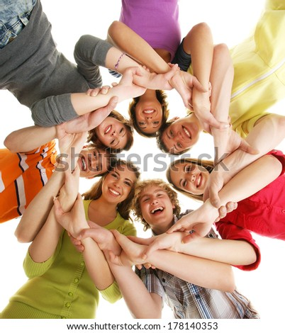 Group of smiling happy teenagers isolated on white - stock photo
