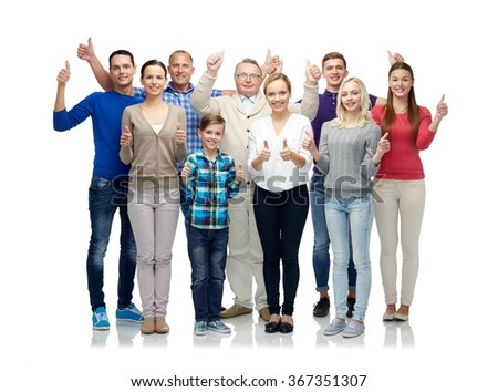 group of smiling people showing thumbs up - stock photo