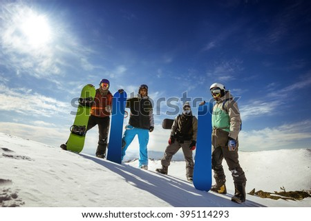Group of snowboarders stands on the top of the mountain. Sheregesh resort, Siberia, Russia - stock photo