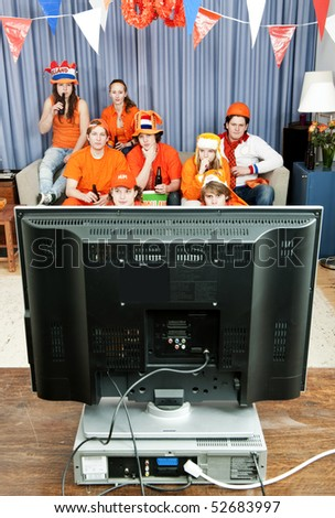 Group of soccer fans watching a game on television - stock photo
