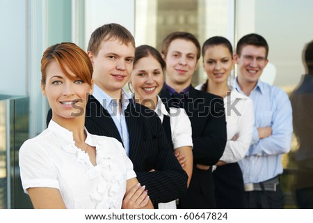 Group of some business people working in the open air office (WARNING! Focus only on the red head's face) - stock photo