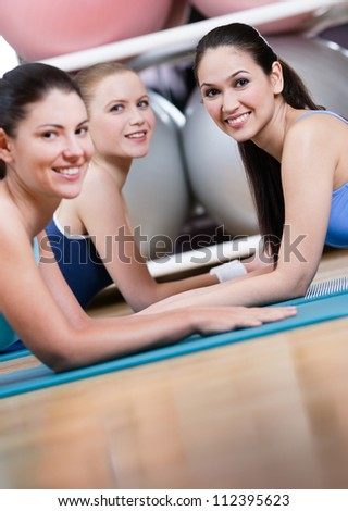 Group of sport women have a rest in the gym centre - stock photo