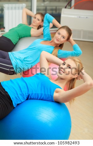 Group of sportive young women in the gym centre. - stock photo