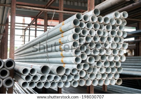Group of Stack of iron pipes in an iron shop - stock photo