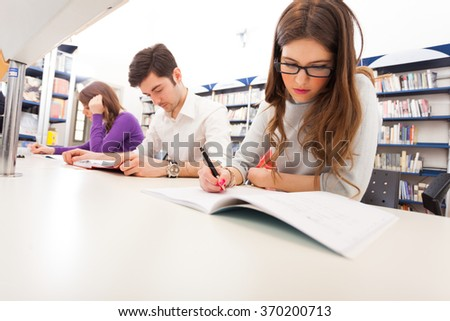 Group of students at work - stock photo