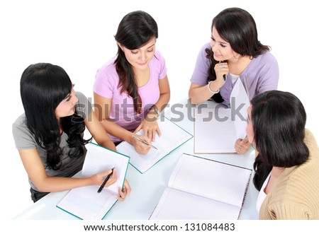 group of students having discussion making homework - stock photo