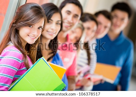 Group of students in a row and smiling - stock photo