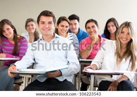 Group of students in class looking very happy - stock photo