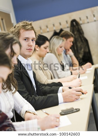 Group of students in the classroom - stock photo