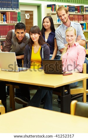 Group of students learning in library at university - stock photo