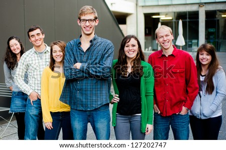 Group of students outside together smiling - stock photo