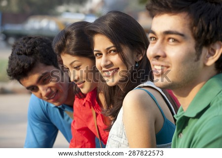Group of students sitting together - stock photo